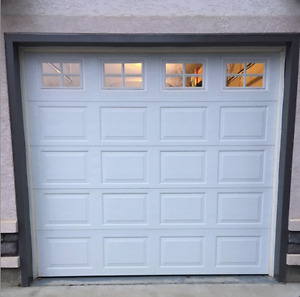 A Traditional White 9x8 Overhead Garage Door with Hardware