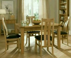 Oak dinning table and chairs with matching sideboard and display cabinet