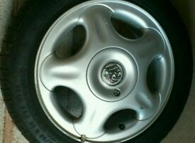2 x Vauxhall Corsa starfish alloy wheels with centre caps and good tyres