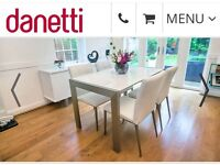 Danetti White Gloss Extending Dining Table with 4 grey leather chairs