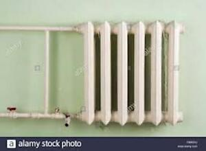 WALL CAST IRON RADIATOR -PRICED  FOR QUICK SALE