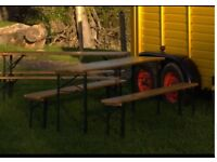 Foldaway wooden tables with benches