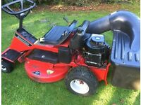 Snapper Ride on mower with scarifier attachment