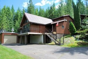 Very Private 2.2 Acres with 2 Homes Across From Shuswap Lake
