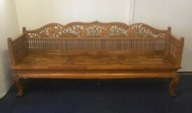 A stunning custom hand carved teak elephant bench very long
