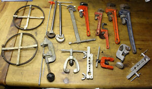 Plumbing tools hand and a huge lot of fixtures & tiny pieces