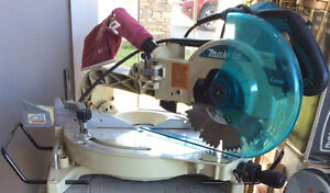 Makita Sliding Compund Mitre Saw and a Stand
