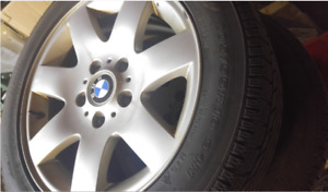 4 original BMW rims and winter tires (only used a few months)