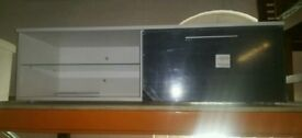 A brand new white x grey 1 door TV unit with glass shelves x led light.