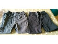 Two pairs of Tu slim fit trousers 6-7 years old
