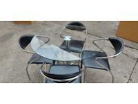 MODERN GLASS DINING TABLE WITH 4 BLACK LEATHER CHAIRS