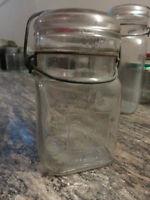 Vintage mason jars/glass lids/great shape