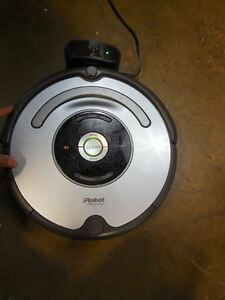 USED IROBOT ROOMBA VACUUM CLEANING ROBOT
