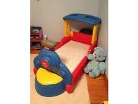 Little tikes train bed. Good condition with storage compartment and working light.
