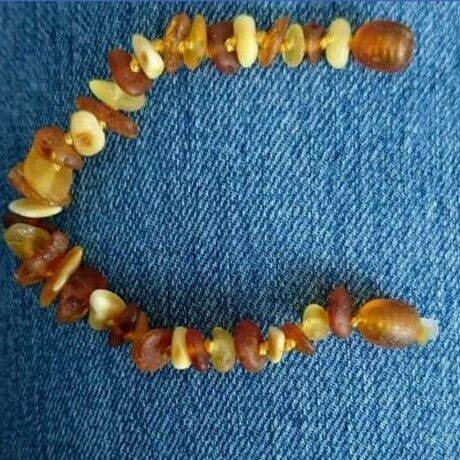 Brand new amber bracelet with safety knots