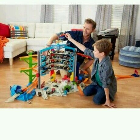 Hotwheels mega garage with extra cars, track and racing loop track