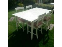 White Ikea dining table and 6 chairs