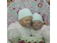 2 sleeping reborn babies