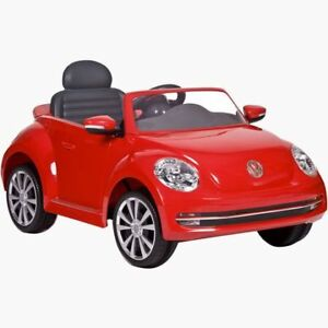 Kids Red Volkswagen Beetle. Used a couple times.(Walmart)
