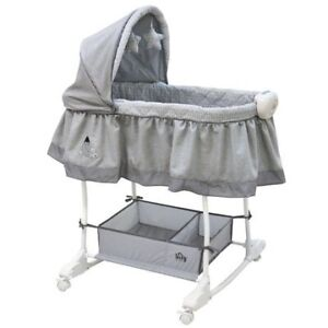 Never used - Bily Rocking Bassinet - worth 100$ with tax.