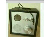 Clock alarm radio with AUX speaker built in