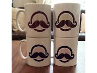 Four mugs by Siempre Bicycle Cafe. New and unused.