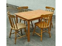 Tile top table and 4 solid pine chairs very sturdy tiled top
