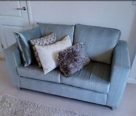 NEW! Two green sofas for sale.