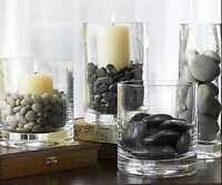 tons of black rocks for sale and centerpieces
