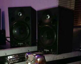 A pair of Yamaha MSP3 powered studio monitor speakers.