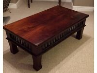 Rustic dark wood Eastern style coffee table