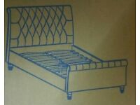 A brand new still boxed mink colour fabric king size bed frame with dimonti detail.
