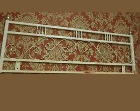 White metal double bed headboard