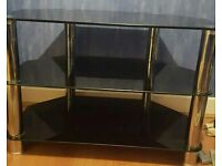 "Black glass Tv stand. 32"" - 42"""