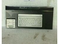 BRAND NEW FREEDOM EXPRESSION BLUETOOTH WIRELESS KEYBOARD