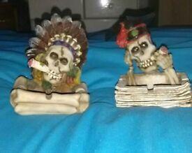 A pair of funny skull ashtrays