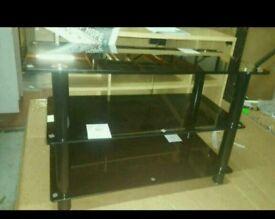 A brand new 3 tier black glass TV unit .