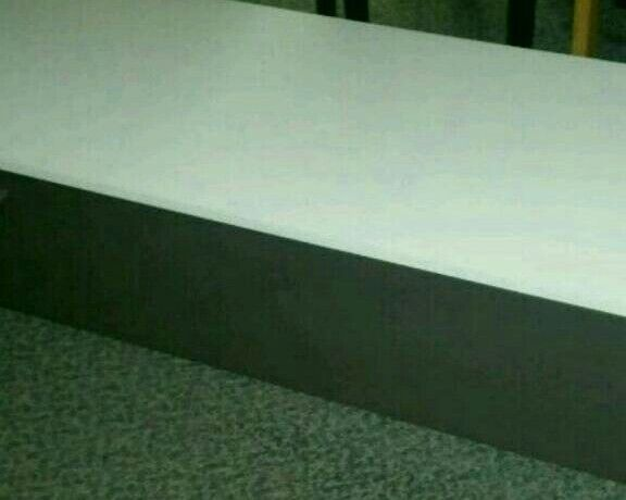 A brand new white and black large wall mounted TV unit.