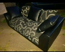 Two peice black and grey patterned sofa