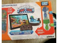 Skylanders trap team for iPad or tablet with bag of figures