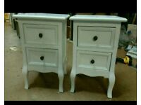 A brand new pair of stylish white 2 drawer bedside tables.