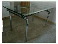 Clear glass extendable dining table without chairs