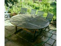 Large extending wooden garden/patio table. Needs work!