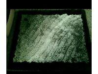 Black by grey furry rug