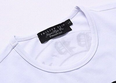 On the left is the tag on a Real Philipp Plein T-shirt. And on the right is the tag on a Fake Philipp Plein T-shirt.