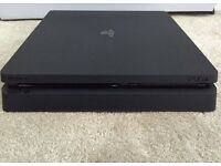 1TB PS4 slim with game