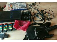 Mixed bundle PS2 games & console sold as seen