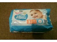 Swim nappies open packet with 8 unused nappies size 3