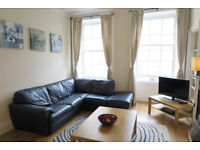 Double bedroom with spacious lounge with feature fireplace, fitted kitchen/dining