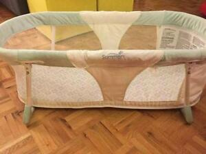 Bassinet Includes mattress pad and fitted sheet
